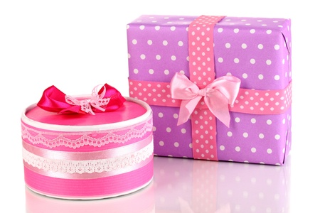 contrasty: Colorful pink and purple gifts isolated on white