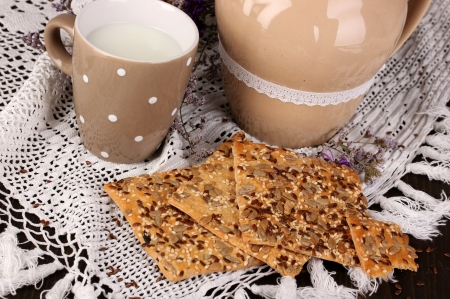 microelements: Pitcher and cup of milk with cookies on wooden table close-up Stock Photo