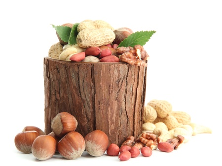 assortment of tasty nuts with leaves in wooden vase, isolated on white Stock Photo - 16141534