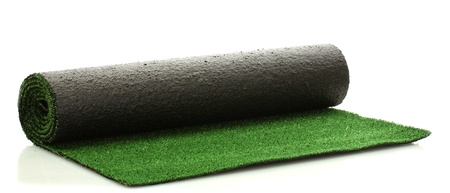 artificial rolled green grass, isolated on white photo