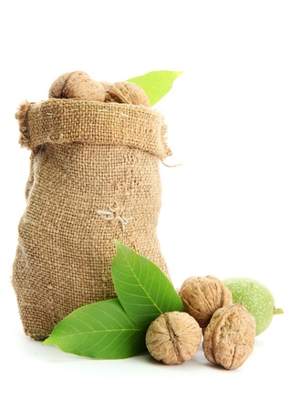walnuts with green leaves in  burlap bag, isolated on white Stock Photo - 16191365