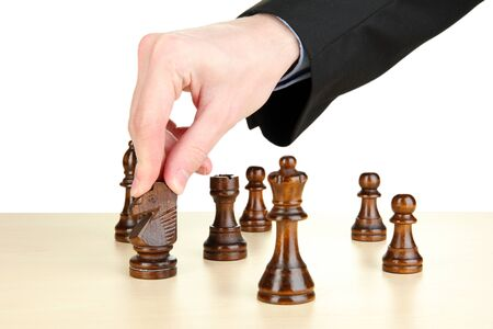 businessman playing chess isolated on white  photo