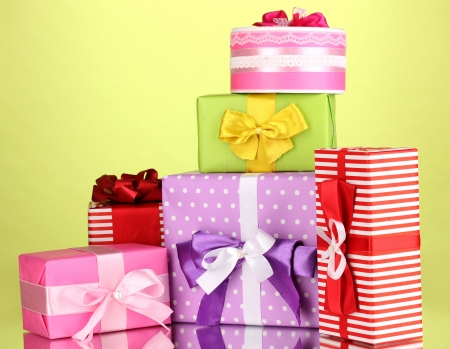 contrasty: Colorful gifts on green background