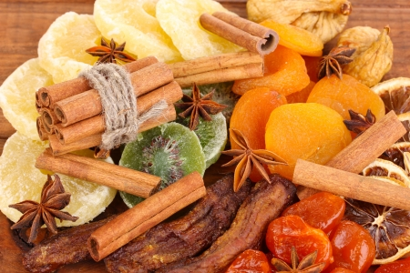 Dried fruits with cinnamon and anise stars close-up photo