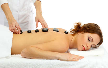beautiful young woman in spa salon getting massage with spa stones Stock Photo - 17185861