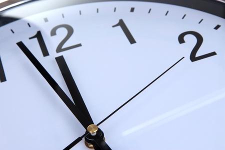 beat the clock: round office clock close up Stock Photo