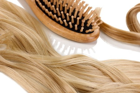 hair highlights: Blond curls brushing comb isolated on white Stock Photo