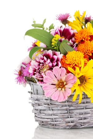 gift basket: beautiful bouquet of bright flowers in basket isolated on white