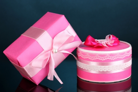 Colorful pink gifts on blue background photo