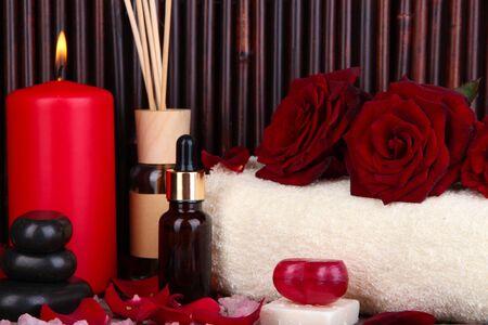 Beautiful spa setting on bamboo background photo