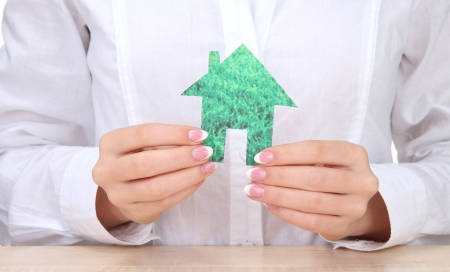 concept: woman hands with paper house, close up Stock Photo - 16194749