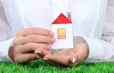 concept: woman hands with paper house, close up Stock Photo - 16194785
