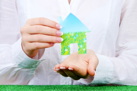 concept: woman hands with paper house, close up Stock Photo - 16195492