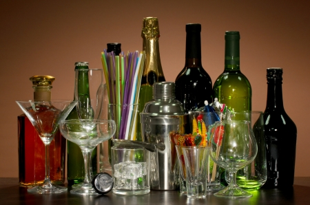 Collection of various glasses and drinks on color background photo
