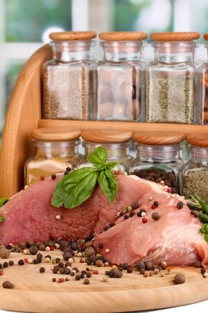 A large piece of pork marinated with herbs and spices close-up on white table on window background Stock Photo - 16246076