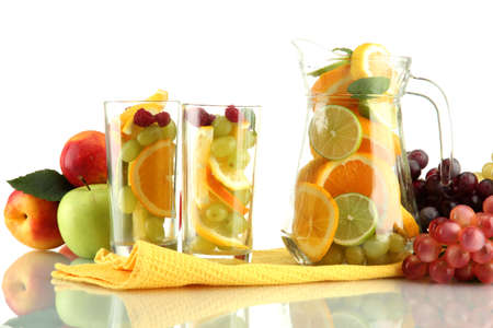 transparent jar and glasses with citrus fruits, isolated on white Stock Photo - 16244548