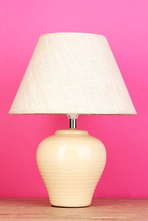 table lamp on pink background photo