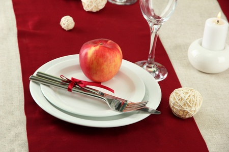 beautiful holiday table setting with apple, close up photo