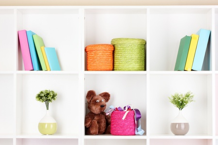 Color wicker boxes on cabinet shelves Stock Photo - 16244602