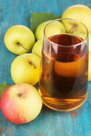 apple juice: Useful apple juice with apples around on wooden table