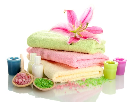 towels with lily, aroma oil,  candles and sea salt isolated on white Stock Photo - 16277832