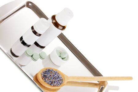 Alternative therapies on the silver tray on white background close-up Stock Photo - 16277157