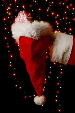 Santa Claus hand holding gifts on bright background Stock Photo - 16277691