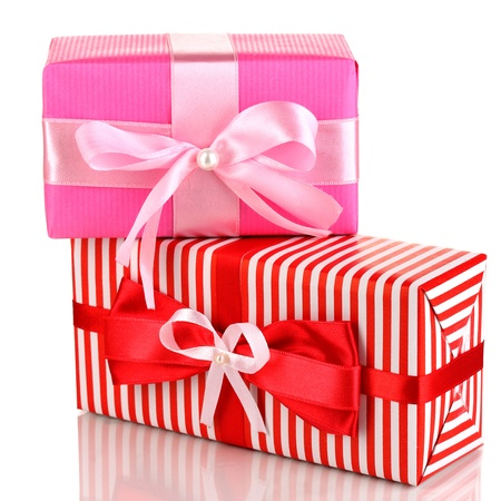 Colorful red and pink gifts isolated on white photo
