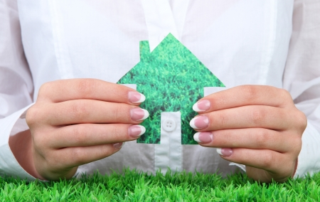 concept: woman hands with paper house, close up Stock Photo - 16278663