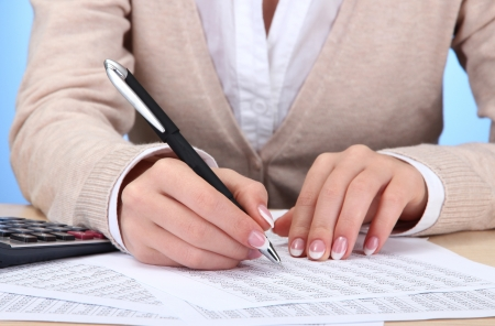Closeup of businesswoman hands, working in office room photo