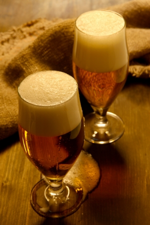 Glasses of beer on wooden table close-up Stock Photo - 16279718