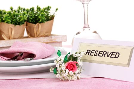 Table setting with reserved card in restaurant Stock Photo - 16282512
