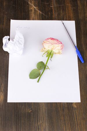 Creation of composition and crumpled sheets on wooden table photo