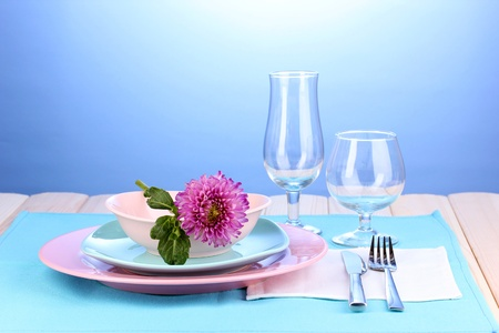 Table setting on bright background close-up photo