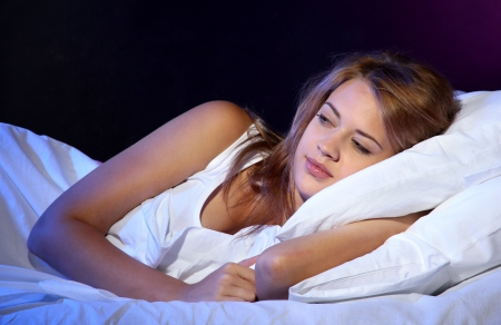 young beautiful woman sleeping on bed in bedroom Stock Photo - 17129736