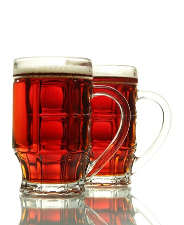two tankards of kvass, isolated on white photo