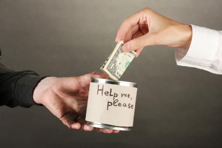 helping the homeless, on black background close-up Stock Photo - 16282855