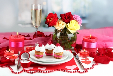Table setting in honor of Valentines Day on room background photo