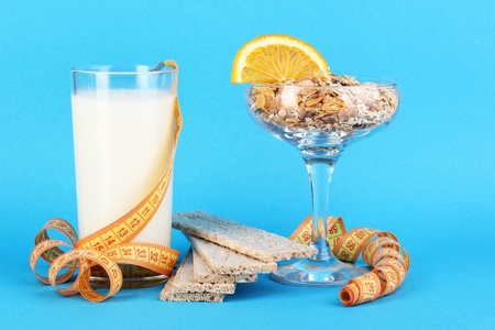 Lungs muesli in vase for desserts and glass milk on blue background Stock Photo - 16283647