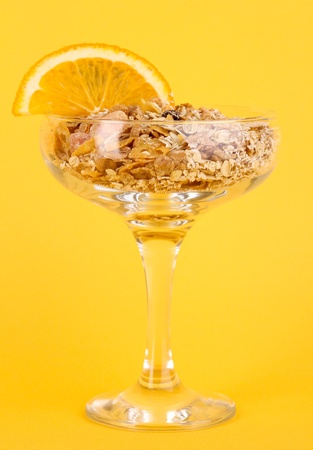 Lungs muesli in vase for desserts on yellow background Stock Photo - 16281614