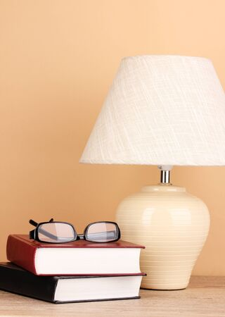 table lamp and books on beige background Stock Photo - 16282515
