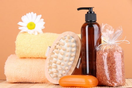 Set for care of a body on peach background Stock Photo - 16292134