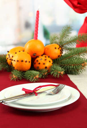 beautiful christmas table setting with tangerines and fir tree, close up photo
