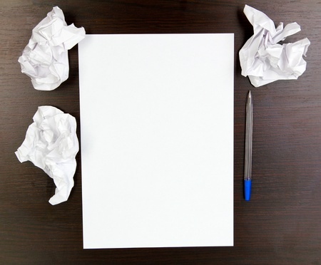 empty paper, crumpled paper and pen on wooden table Stock Photo - 16329400