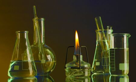 spiritlamp and test-tubes on blue-yellow background photo