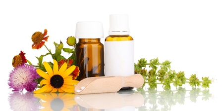 essence: medicine bottles with tablets and flowers isolated on white Stock Photo