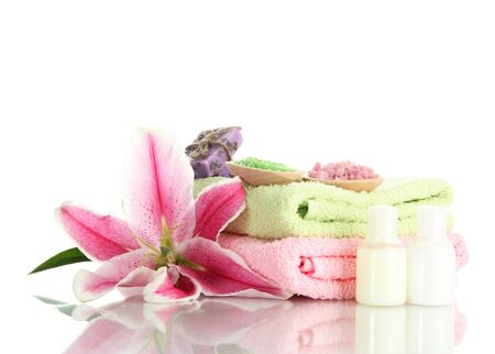 towels with lily, aroma oil, soap and sea salt isolated on white photo