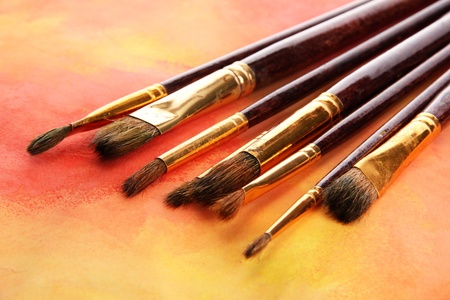 brushes on bright abstract gouache painted background Stock Photo - 16329531