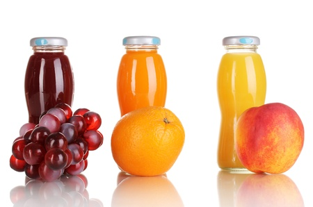 Delicious grapes, orange and apple juice in glass bottle and fruit next to it isolated on white Stock Photo - 16339626