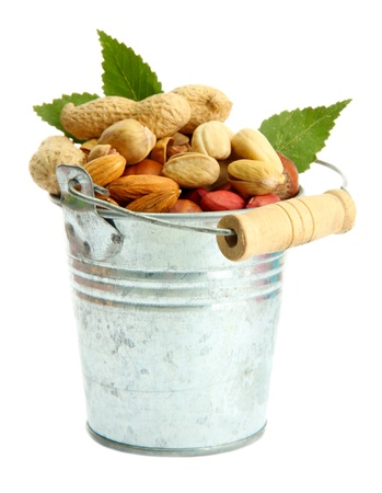 assortment of tasty nuts with leaves in pail, isolated on white Stock Photo - 16339364